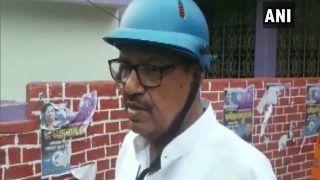 #WestBengalElections2021 LIVE: TMC-BJP कार्यकर्ताओं के बीच हिंसक झड़प, हेल्मेट पहन वोट देने पहुंचे ममता के मंत्री