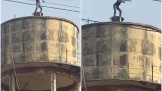 Man Under Influence of Alcohol Climbs Water Tank & Does a Hilarious Drunk Dance | Watch Video