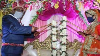 Socially-Distanced Wedding: Bride And Groom Use Bamboo Sticks to Garland Each Other | See Pics