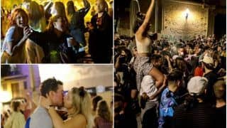 Celebrations Erupt in Spain As Couples Kiss on Streets, Thousands Sing & Dance to Mark Lockdown End