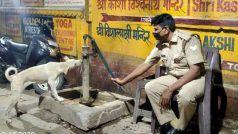 प्यासे कुत्ते को पुलिसवाले ने हैंडपंप चलाकर पिलाया पानी, Viral Photos ने जीता लोगों का दिल