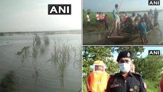 UP: रात में कुशीनगर में नदी की बची मझधार में फंसी नाव , करीब 100-150 लोगों को सुरक्षित निकाला गया