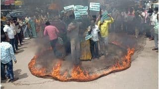TDP Workers Protest Against Fuel Price Hike By Standing Inside Ring Of Fire In Andhra Pradesh   Watch