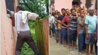 Desi Jugaad: Man Gets Covid Jab Through Window at Vaccine Centre As People Stand in Long Queue | Watch