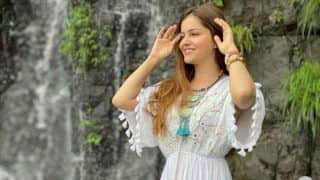 Rubina Dilaik Looks Breathtaking in White Long Dress as She Enjoys Vacation by The WaterFall