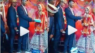 Viral Video:Bride Turns Her Face Away After Groom's Friend Gives An Embarrassing Gift As a Joke | Watch
