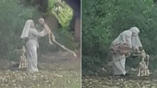 Woman Dressed As Nun Plays & Dances With Skeleton Near Graveyard, People Wonder If It's a Prank!