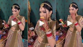 Viral Video: Hungry Bride Enjoys Eating a Pizza McPuff Before Her Wedding   Watch