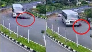 Viral Video: Man Miraculously Escapes Unhurt After Getting Run Over By Bus in Gujarat's Dahod   Watch