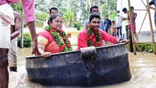 Viral Video: Kerala Bride & Groom Reach Flooded Wedding Venue in Cooking Vessel, Get Married | Watch