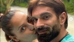 Bipasha Basu ने  पति को Kiss हुए की रोमांटिक फोटो शेयर, लोग बोलें- बालों में सफेदी आ गई