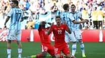 Argentina and Belgium claim last World Cup last eight places