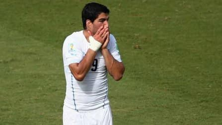 Uruguay star striker Luis Suarez banned for nine matches, four months over biting