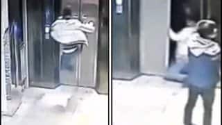 CCTV footage reveals how man broke both his legs fly-Kicking elevator door!